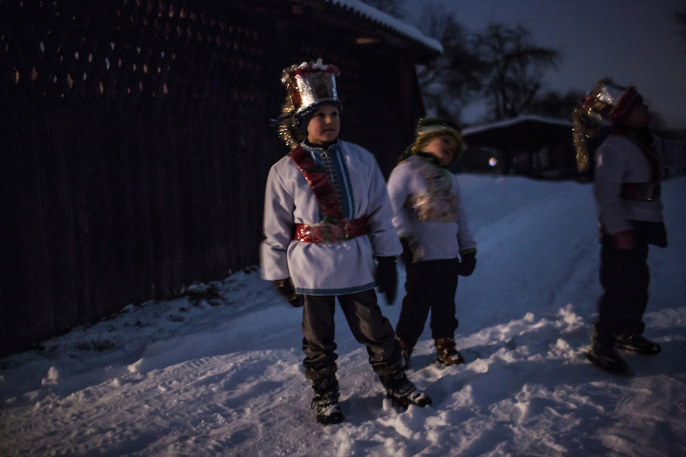 ILTSI, UKRAINE - JANUARY 6: Vasyl, Stas, and Nazar Mahulia (L-R), ages 7, 5, and 6 respectively, pause while caroling door to door in celebration of Orthodox Christmas on January 6, 2015 in Iltsi, Ukraine. While many of the traditions are similar across Ukraine, the songs and clothing of the Hutsul culture are common in the Carpathian Mountains. (Photo by Brendan Hoffman/Getty Images) *** Local Caption *** Vasyl Mahulia;Stas Mahulia;Nazar Mahulia