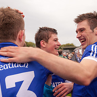 Conor Ryan congratulates his team mate Cathal McInerny after their win of the Clare County Senior Final in Cusack Park