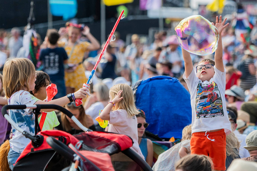 Henham Park, Suffolk, 21 July 2019. Children enjoy bubbles in the Obelisk Arena. The 2019 Latitude Festival.