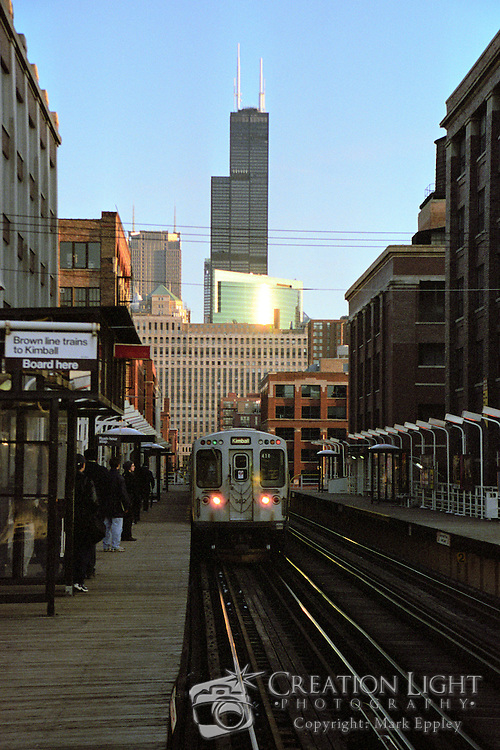 The L Trains, so named because they are elevated above the streets, provide public transporation throughout Chicago. Picture of the Brown Line train north of the loop.
