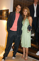 BRUCE WILPON and his wife YUKI OSHIMA-WILPON , he is the son of Fred Wilpon, the New York multimillionaire real-estate developer who the New York Mets baseball team at the opening of the new Diesel shop at 130 New Bond Street, London W1 on 18th May 2006.<br />