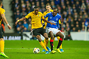 Glen Kamara (#18) of Rangers FC tackles Christopher Martins Pereira (#35) of BSC Young Boys during the Europa League Group G match between Rangers FC and BSC Young Boys at Ibrox Park, Glasgow, Scotland on 12 December 2019.