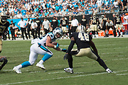 Christian McCaffrey(22) tries to get around Vonn Bell(48) in the New Orleans Saints 34 to 13 victory over the Carolina Panthers.