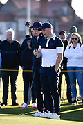 Conor Purcell (GB&I) and Alex Fitzpatrick (GB&I) discuss a putt on the first green during the Sunday Foursomes in the Walker Cup at the Royal Liverpool Golf Club, Sunday, Sept 8, 2019, in Hoylake, United Kingdom. (Steve Flynn/Image of Sport)