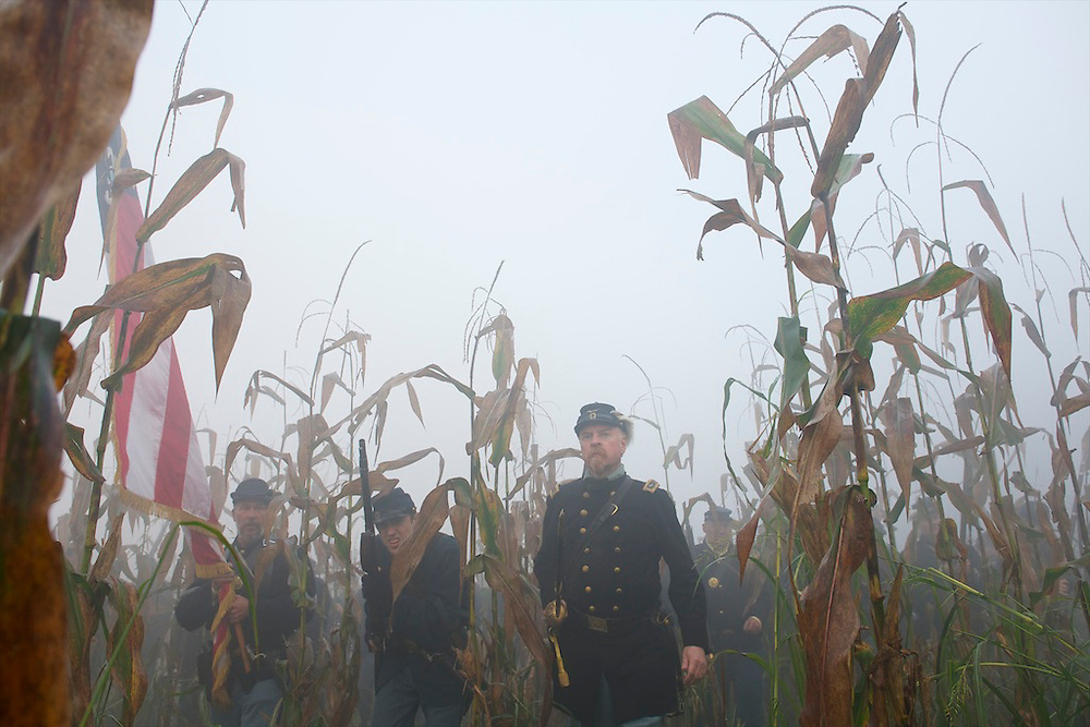 Union troops navigate a cornfield amid heavy fog during the 150th Antietam Civil War Reenactment weekend in Boonsboro, Maryland on September 9, 2012.