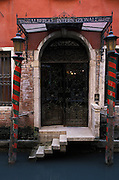 Architectural detail of entrance to a hotel from canal in Venice, Italy..Subject photograph(s) are copyright Edward McCain. All rights are reserved except those specifically granted by Edward McCain in writing prior to publication...McCain Photography.211 S 4th Avenue.Tucson, AZ 85701-2103.(520) 623-1998.mobile: (520) 990-0999.fax: (520) 623-1190.http://www.mccainphoto.com.edward@mccainphoto.com.