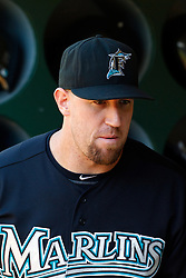 June 29, 2011; Oakland, CA, USA; Florida Marlins catcher John Buck (14) stands in the dugout before the game against the Oakland Athletics at the O.co Coliseum.  Florida defeated Oakland 3-0.