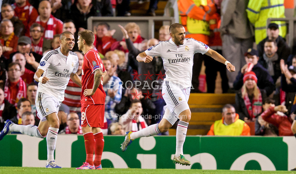 LIVERPOOL, ENGLAND - Wednesday, October 22, 2014: Real Madrid CF's Karim Benzema celebrates scoring the third goal against Liverpool during the UEFA Champions League Group B match at Anfield. (Pic by David Rawcliffe/Propaganda)