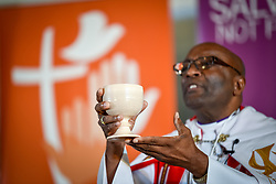 "10 May 2017, Windhoek, Namibia: Bishop Ernst Gamxamub from the Evangelical Lutheran Church in the Republic of Namibia distributing Holy Communion at the opening worship of the Lutheran World Federation's Twelfth Assembly. The Twelfth Assembly of the Lutheran World Federation, gathers in Windhoek, Namibia, on 10-16 May 2017, under the theme ""Liberated by God's Grace"", bringing together some 800 delegates and participants from 145 member churches in 98 countries."