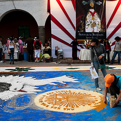 People decorate a procession route with flower petals and drawings during Holy Week celebrations in Ayacucho, Peru.