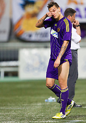 Injured Soares Bordignon Arghus #44 of Maribor crying during football match between NK Maribor and APOEL FC, (Cyprus) in Third qualifying round, Second leg of UEFA Champions League 2014, on August 6, 2013 in Stadium Ljudski vrt, Maribor, Slovenia. (Photo by Vid Ponikvar / Sportida.com)