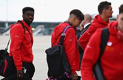 BASEL, SWITZERLAND - MAY 16: Liverpool's Kolo Toure arrives at Basel airport ahead of the UEFA Europa League Final against Sevilla. Alberto Moreno, Jordon Ibe, James Milner, Daniel Sturridge. (Photo by UEFA/Pool)