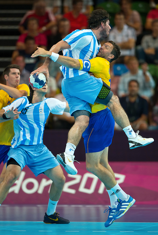 Argentina's Sebastian Simonet, top center, was blocked by Sweden's Tobias Karlsson, right in yellow jersey, during a men's handball preliminary Group A match at the Copper Box during the 2012 Summer Olympic Games in London, England, Saturday, August 4, 2012. Sweden won the match 29-13. (David Eulitt/Kansas City StarMCT)