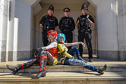 © Licensed to London News Pictures. 08/04/2017. London, UK. Kyashi and Jinxy Dragon sit in front of real City of London policemen as participants take part in the inaugural Games Character Parade, walking from Guildhall to Paternoster Square.  The event formed part of the London Games Festival welcoming cosplayers, wearing costumes inspired by videogame characters, to the UK's biggest parade of cosplayers.   Photo credit : Stephen Chung/LNP