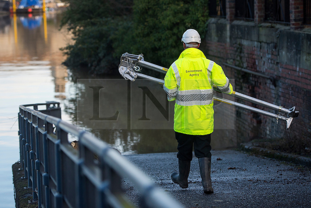 © Licensed to London News Pictures. 29/12/2015. York, UK. A members of the environment agency working near the  Foss Barrier while it is closed in York city centre. Several warnings of risk to life are sill in place in parts of Lancashire and Yorkshire where rainfall has been unusually high, causing heavy flooding. Photo credit: Ben Cawthra/LNP