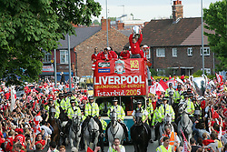 LIVERPOOL, ENGLAND - THURSDAY, MAY 26th, 2005: Liverpool players Luis Garcia, Jamie Carragher, Steven Gerrard and John Arne Riise parade the European Champions Cup on on open-top bus tour of Liverpool in front of 500,000 fans after beating AC Milan in the UEFA Champions League Final at the Ataturk Olympic Stadium, Istanbul. (Pic by David Rawcliffe/Propaganda)