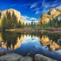 El Capitan and the Cathedral Rocks reflected in the Merced River, Yosemite National Park, California.