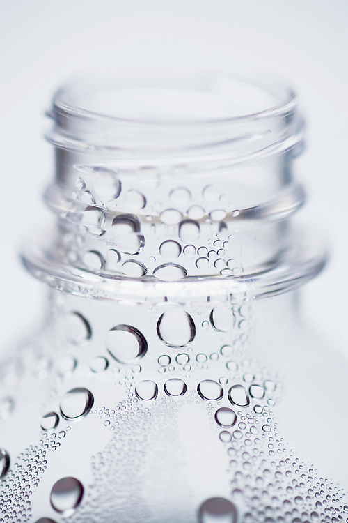 Plastic water bottle with water droplets.