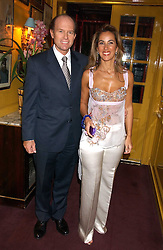 MR & MRS ANDREAS TSAVLIRIS at a dinner hosted by Stratis & Maria Hatzistefanis at Annabel's, Berkeley Square, London on 24th March 2006 following the christening of their son earlier in the day.<br />