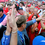 A fan high-fives Mississippi head coach Hugh Freeze during the Walk of Champions before an NCAA college football game in Oxford, Miss., Saturday, Sept. 15, 2012. (Photo/Thomas Graning)