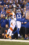 Indianapolis Colts wide receiver T.Y. Hilton pulls in a long second quarter pass near the sidelines in front of Cincinnati Bengals cornerback Adam Jones. Indianapolis hosted Cincinnati in the first round of the NFL Playoffs Sunday, January 4, 2015.
