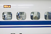 business people sitting inside a Shinkansan train compartment waiting to leave the station Japan Kyoto