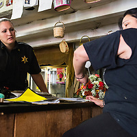 Sergeant Crumley speaks to the local florist who was the victim of an assault and takes her statement. The victim explained that her daughter's boyfriend had stolen money from the business and when confronted had assaulted her. Sergeant Crumley explained later that the whole story was very complicated; the victim was actually in a prior relationship with the man who assaulted her and the suspect is now dating her daughter who is a juvenile.