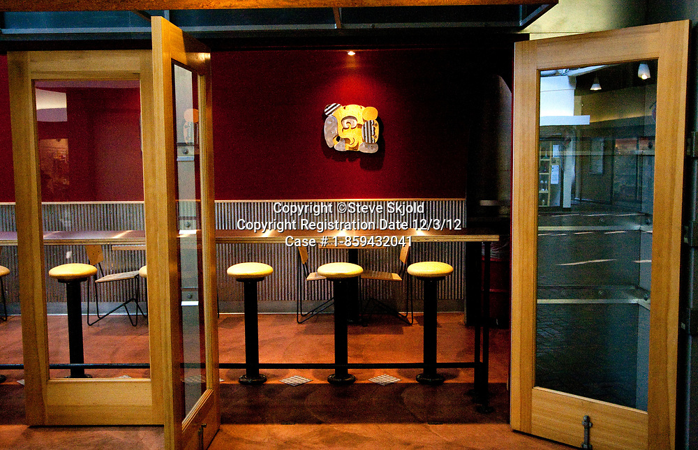 Entrance to fast food restaurant with long table and stools for fast service on Grand Avenue. St Paul Minnesota MN USA