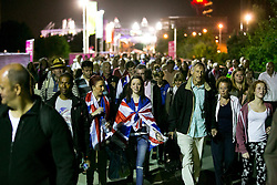 © Licensed to London News Pictures.03/08/2012 LONDON UK. Athletics fans leaving the Olympic Stadium after the first day track and field competition Photo credit : Andrew Baker/LNP