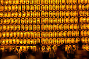 People walk past a large wall of yellow lanterns, each displaying the name of a fallen military serviceman, during the Mitama matsuri or festival of remembrance at Yasukuni Shrine Tokyo, Japan. Monday, July 13th 2009