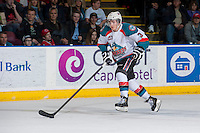 KELOWNA, CANADA - APRIL 19: Riley Stadel #3 of the Kelowna Rockets skates with the puck against the Portland Winterhawks  on April 18, 2014 during Game 2 of the third round of WHL Playoffs at Prospera Place in Kelowna, British Columbia, Canada.   (Photo by Marissa Baecker/Shoot the Breeze)  *** Local Caption *** Riley Stadel;