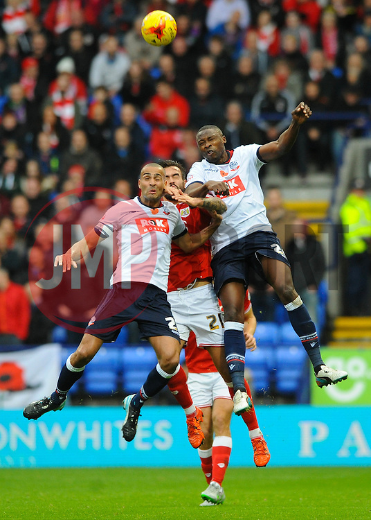 Marlon Pack of Bristol City challenges for the header with Darren Pratley of Bolton Wanderers and Shola Ameobi - Mandatory byline: Dougie Allward/JMP - 07966 386802 - 07/11/2015 - FOOTBALL - Macron Stadium - Bolton, England - Bolton Wanderers v Bristol City - Sky Bet Championship
