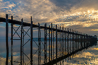 Sunrise in the U Bein Bridge in Amarpura in the Mandalay Region in Myanmar