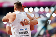 Great Britain, London - 2017 August 05: (L) Konrad Bukowiecki (Gwardia Szczytno) and Jakub (R) Szyszkowski (Slask Wroclaw) both from Poland hug each other while men&rsquo;s shot put qualification during IAAF World Championships London 2017 Day 2 at London Stadium on August 05, 2017 in London, Great Britain.<br /> <br /> Mandatory credit:<br /> Photo by &copy; Adam Nurkiewicz<br /> <br /> Adam Nurkiewicz declares that he has no rights to the image of people at the photographs of his authorship.<br /> <br /> Picture also available in RAW (NEF) or TIFF format on special request.<br /> <br /> Any editorial, commercial or promotional use requires written permission from the author of image.