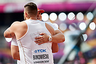 Great Britain, London - 2017 August 05: (L) Konrad Bukowiecki (Gwardia Szczytno) and Jakub (R) Szyszkowski (Slask Wroclaw) both from Poland hug each other while men's shot put qualification during IAAF World Championships London 2017 Day 2 at London Stadium on August 05, 2017 in London, Great Britain.<br /> <br /> Mandatory credit:<br /> Photo by © Adam Nurkiewicz<br /> <br /> Adam Nurkiewicz declares that he has no rights to the image of people at the photographs of his authorship.<br /> <br /> Picture also available in RAW (NEF) or TIFF format on special request.<br /> <br /> Any editorial, commercial or promotional use requires written permission from the author of image.
