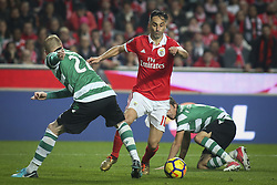 January 3, 2018 - Lisbon, Portugal - Benfica's forward Jonas (C) vies with Sporting's defender Jeremy Mathieu (L)  during the Portuguese League  football match between SL Benfica and Sporting CP at Luz  Stadium in Lisbon on January 3, 2018. (Credit Image: © Carlos Costa/NurPhoto via ZUMA Press)