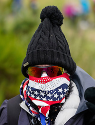 Auchterarder, Scotland, UK. 14 September 2019. Saturday morning Foresomes matches  at 2019 Solheim Cup on Centenary Course at Gleneagles. Pictured; Team USA fan wearing warm hat and scarf to protect against cold weather.  Iain Masterton/Alamy Live News