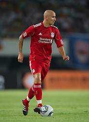GUANGZHOU, CHINA - Wednesday, July 13, 2011: Liverpool's Jonjo Shelvey in action against Guangdong Sunray Cave during the first pre-season friendly on day three of the club's Asia Tour at the Tianhe Stadium. (Photo by David Rawcliffe/Propaganda)