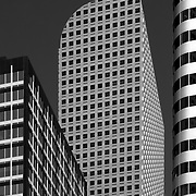 Black and white photograph of Wells Fargo Center and surrounding buildings in downtown Denver, Colorado.  Designed by architect Philip Johnson.  It is also known as the cash register building.