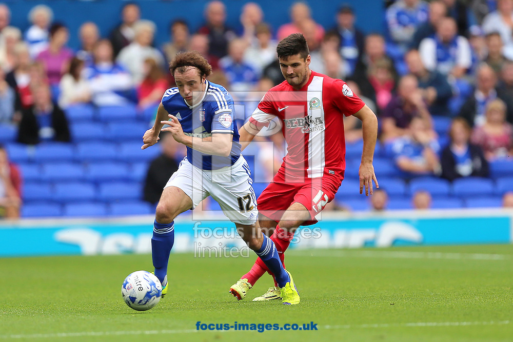 Stephen Hunt of Ipswich Town breaks with ball with Ben Marshall of Blackburn Rovers in pursuit during the Sky Bet Championship match at Portman Road, Ipswich<br /> Picture by Richard Calver/Focus Images Ltd +447792 981244<br /> 18/10/2014
