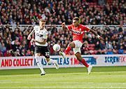 Middlesbrough forward Britt Assombalonga (9) tries to go past Swansea City defender Joe Rodon (22)  during the EFL Sky Bet Championship match between Middlesbrough and Swansea City at the Riverside Stadium, Middlesbrough, England on 22 September 2018.