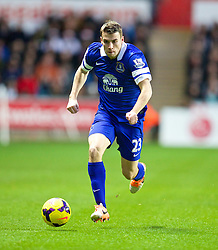 SWANSEA, WALES - Sunday, December 22, 2013: Everton's Seamus Coleman in action against Swansea City during the Premiership match at the Liberty Stadium. (Pic by David Rawcliffe/Propaganda)