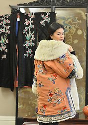 Viewing Assistant Eraena Valery models a mid 19th century fur-lined kimono from the Ching Dynastly in China in preparation for the rare whisky and Asian artifacts sales at Bonham's in Edinburgh this week.<br /> <br /> © Dave Johnston/ EEm