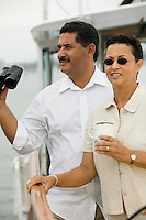 Couple on Boat with Binoculars and Coffee Cup