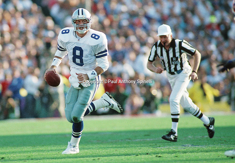 Dallas Cowboys quarterback Troy Aikman (8) scrambles during the NFL Super Bowl XXVII football game against the Buffalo Bills on Jan. 31, 1993 in Pasadena, Calif. The Cowboys won the game 52-17. (©Paul Anthony Spinelli)