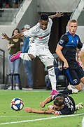 LAFC forward Latif Blessing (7) hurdles San Jose Earthquakes defender Guram Kashia (37) during an MLS soccer match. LAFC defeated the Earthquakes 4-0 on  Wednesday, Aug. 21, 2019, in Los Angeles. (Ed Ruvalcaba/Image of Sport)