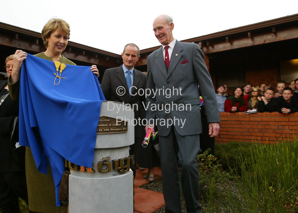 14/11/2002.The President of Ireland Mary McAleese pictured yesterday unveiling a commemorative sculpture to celebrate 50 years of Foroige.The President unveiled the sculpture at Colaiste Cois Siuire in Mooncoin County Kilkenny. Also in the picture is Seamus Doran the first leader of Foroige (then known as Macra Na Tuaithe) far right and Dr Martin McAleese center..Picture Dylan Vaughan