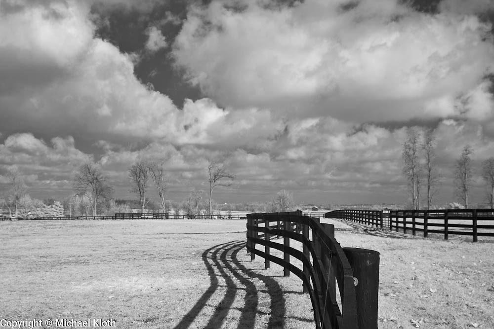 Plainfield Farm horse pasture in rural Kentucky - fence with clouds.  Infrared (IR) photograph by fine art photographer Michael Kloth. Black and white infrared photographs