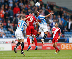 Kike of Middlesbrough and Lee Peltier of Huddersfield compete in the air - Photo mandatory by-line: Rogan Thomson/JMP - 07966 386802 - 13/09/2014 - SPORT - FOOTBALL - Huddersfield, England - The John Smith's Stadium - Huddersfield town v Middlesbrough - Sky Bet Championship.