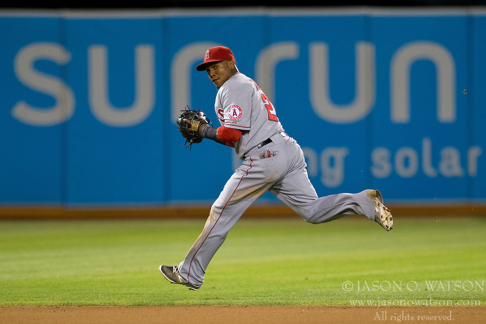OAKLAND, CA - SEPTEMBER 23:  Erick Aybar #2 of the Los Angeles Angels of Anaheim fields a ground ball against the Oakland Athletics during the seventh inning at O.co Coliseum on September 23, 2014 in Oakland, California. The Los Angeles Angels of Anaheim defeated the Oakland Athletics 2-0.  (Photo by Jason O. Watson/Getty Images) *** Local Caption *** Erick Aybar